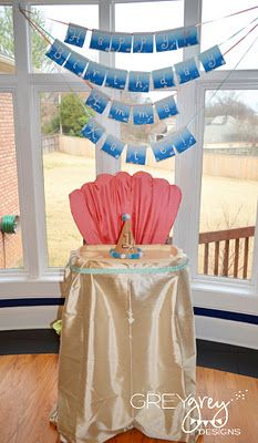 Under the Sea 1st b-day party. Love how the high chair is transformed into a clam shell!