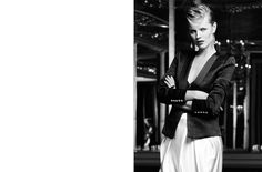 Czech born, Eva Herzigova - Blazer and pants by Balmain; body by Kiki de Montparnasse; earrings by Chloé; ring by Saint Laurent by Hedi Slimane