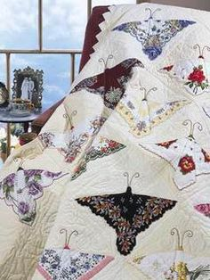 quilt...the butterflies are made from old vintage hankerchiefs.