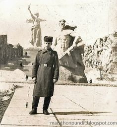 My brother-in-law in the Soviet Army in front of the Stalingrad statue