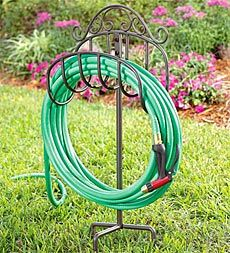 Wrought Iron Portable Hose Holder with Stake.  (High on my wish list)  In May, I bought it and it is better than I thought!!