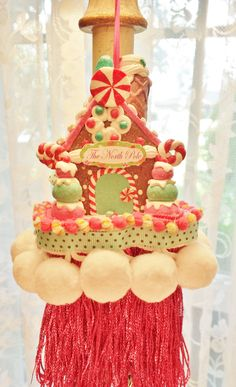 The North Pole Decorative Tassel Gingerbread House Pink Green Red Christmas…