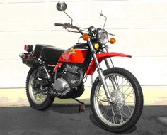 Honda XL350, I had one of this in ca 1978, I remember it being so heavy but if there was good traction the front wheel lifted easily. Mine did not have aluminum wheels though.