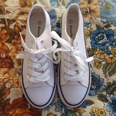 Converse style white sneaker New in box white sneakers. Converse knockout. Amazing condition and very comfortable! Staple for any closet Pierre Dumas Shoes Sneakers