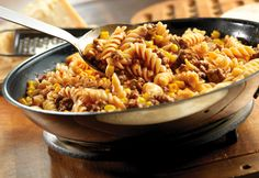 Beef & Rotini Skillet - You'll be rewarded with smiles when you make this quick-cooking skillet dish that mixes seasoned ground beef, corn and pasta in a flavorful tomato sauce. It's sure to become a family favorite. Beef Macaroni, Beef Pasta, Chicken Pasta Recipes, Easy Pasta Recipes, Meat Recipes, Cooking Recipes, Healthy Recipes, Pasta Soup, Healthy Soups