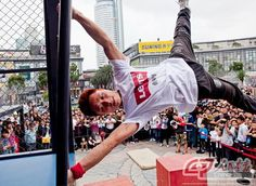 """This young man, nicknamed """"Lion,"""" is an active member of the parkour club. He performs his """"downwind banner"""" nimbly and easily. (Source: China Pictorial)"""