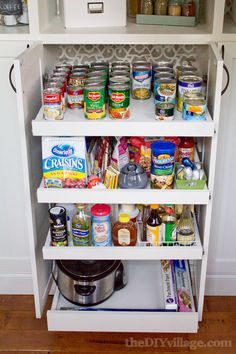GREAT PLACE FOR CROCKS WHEN NOT IN USE.  DIY Custom Pantry Makeover by theDIYvillage.com