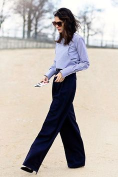 Photo via: Garance Doré We are constantly on the hunt for new office outfits. Luckily, Leila Yavari caught our eye in a blue striped structured shirt, high-waisted wide-leg trousers and pumps. Now, yo