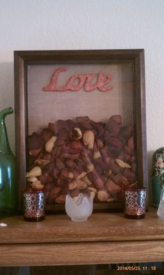 A shadow box is a great way to display dried rose petals from a special someone. I purchased this 11x14 frame, the burlap paper and wooden love sign at Michaels. The frame was a deal at 50% off.