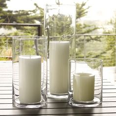 Simple Hurricane   West Elm, can buy these at hobby stores for a lot less! Fill with sand, starfish, seaglass, etc. Put flameless candles in hard to reach areas (with remote)