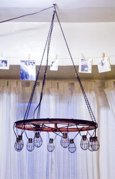 create a vintage chandelier using a wagon wheel and hanging lights