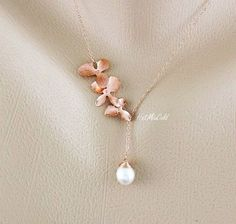 Got this for Xmas!! Rose Gold orchid Necklace pink Orchid and pearl by hotmixcold, $37.00
