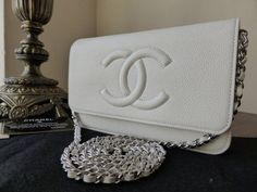 Chanel WOC Wallet on Chain in White Caviar with Silver Tone Hardware > http://www.npnbags.co.uk/naughtipidginsnestshop/prod_3712781-Chanel-WOC-Wallet-on-Chain-in-White-Caviar-with-Silver-Tone-Hardware-As-New.html