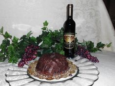 ♥  One of the beautiful cakes our Top Fan will get to choose from.    XOCO Rojo Pound Cake ♥  Chocolate Pound Cake Infused with Horton Vineyards XOCO Rojo Wine    Like them on FB  http://www.facebook.com/heavensgatecatering      and if you cant wait  http://74.220.215.82/~heavenu0/shoponline/index.php/virginia-wine-pound-cakes/chocolate-wine-pound-cake-xoco.html