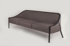 Custom hospitality sofa with metal frame and upholstered seat and back. Wharton Hunt can build this for you.  Learn more about how Wharton Hunt does this at http://www.whartonhunt.com/portfolio/custom-hospitality-seating/