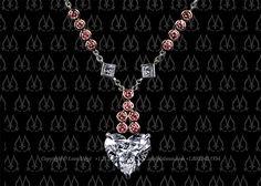 Heart shape diamond pendant with pink diamonds by Leon Mege