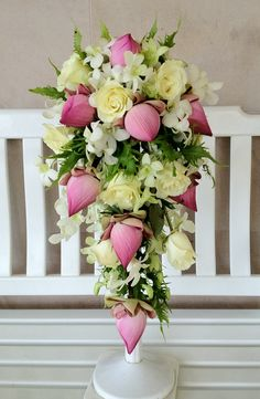 Pink lotus, White rose, White dendrobium orchid.