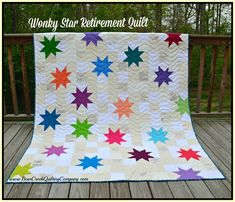 """Wonky Star Retirement Quilt Tutorial-Quilt measures 67 1/2 inches by 77 1/2 inches.  Fabric needed: 32 signed neutral 5"""" square blocks  202 additional neutral 5"""" square blocks (enough of each to make 234)  20 solid color Robert Kaufman Kona Cotton solids for stars  5 yards of  Benartex Felicity in Diamond Aqua for backing  1 yard of  Benartex Felicity in Stripe Teal for binding"""
