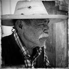 """""""I belong to the people I love, and they belong to me--they, and the love and loyalty I give them, form my identity far more than any word or group ever could.""""   ~ Veronica Roth  Photographer: John Barclay Title: Mexican Man Under Hat Image shared via: AuroraPhotos.com  <3 lis"""