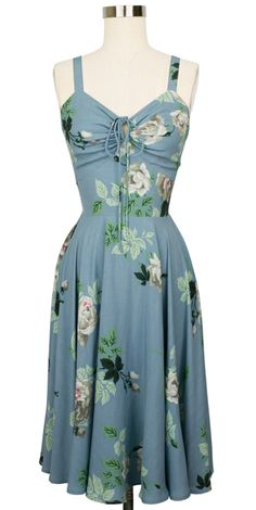 There's a reason we call it the L'Amour Dress— Fall in love with this romantic vintage-inspired summer dress, a sweet wardrobe staple for warmer weather! An easy fit with an accommodating drawstring bust, adjustable button straps, and elastic at the sides meet a knee-length circle skirt perfect for twirling.