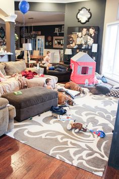 "This is what a real house with real kids living in it looks like ""Aren't you so sick of seeing all these perfectly staged rooms that look like the cleaning lady just swooped through and shined the floors?"" Home Tour Spoof {Living Room} Real Beauty.....life"