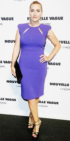 Kate Winslet worked her curves at the Lancome Nouvelle Vague party at Paris Haute Couture Fashion Week in a cut-out violet skin-skimming dress, complete with Ana Khouri jewelry, and black clutch, and killer heels.