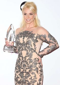 Britney Spears wins her first People's Choice Award for Favorite Pop Artist, January 2014.