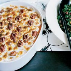 Sweet Potato Gratin with Chile-Spiced Pecans | Jose Garces says this dish best exemplifies his Thanksgiving menu: traditional at its core but with unexpected Latin accents. The gratin is silky and sweet, topped with gooey marshmallows and delightfully crunchy pecans flavored with chile powder.