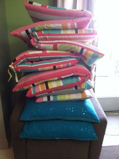 Give your patio furniture a serious facelift with upcycled shower curtain cushion covers.