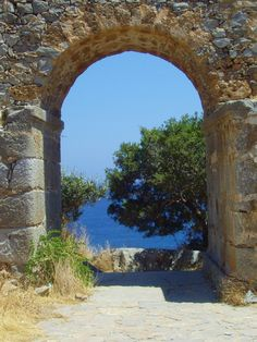 Olive trees through an archway on Spinalonga Island, Crete, Greece. All Original Photography by http://vwcampervan-aldridge.tumblr.com