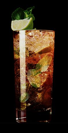 Black Mojito | 2 parts Kraken Rum - 2 slices lime - Muddled mint leaves - 1 tbsp sugar - Top with soda