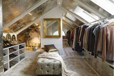 converting room into walk in closet | Image of a attic converted into a walk-in closet.