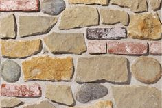 Misto Volterra - B&B Natural Coverings   A typical rustic wall with a strong emotive impact; a combination of stones and bricks (four kinds) in varying proportions. Stones: Deserto/Giallo Reale/Sasso Pontevecchio Brick: Oude Veldsteen.