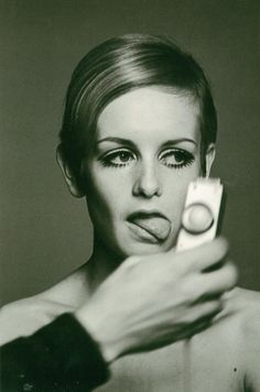 Twiggy at a photo shoot, London, 1966  by Burt Glinn.