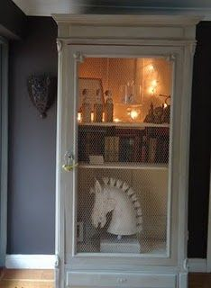 armoire with lights inside to display our antiques