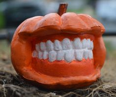 """""""Smile"""" , is a little pumpkin great for halloween. It was sculpted and cast by RubbaDucky.com"""