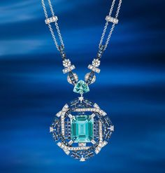 Chaumet A dive into a sea of infinite blue... Necklace in white gold transformable into a brooch, with diamonds, sapphires, aquamarines and one emerald-cut aquamarine.