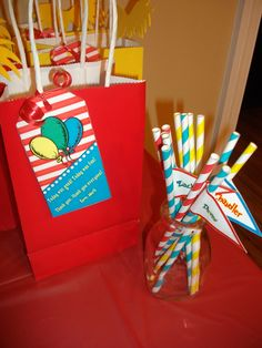dr. seuss party - paper straws with each guests name.