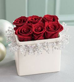 #red rose winter reception centrepiece... Wedding ideas for brides, grooms, parents & planners ... https://itunes.apple.com/us/app/the-gold-wedding-planner/id498112599?ls=1=8 … plus how to organise an entire wedding ♥ The Gold Wedding Planner iPhone App ♥