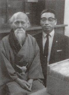 "Masando Sasaki sensei and Aikido Founder Morihei Ueshiba O-Sensei, around 1969, from the blog post ""Interview with Aikido Shihan Masando Sasaki, Part 1 - Falling in love with O-Sensei's face"": http://www.aikidosangenkai.org/blog/archive/2013-03-18/interview-with-aikido-shihan-masando-sasaki-part-1#"