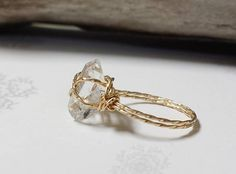 Stunning is the only word to describe the beauty of this unique raw Herkimer Diamond ring! I handpicked these stones myself while in the southern USA this winter keeping warm. I have done a simple wrap using either colored jewelry wire, or sterling silver or 14K gold jewelry wire, which perfectly offsets this natural rough crystal!  This would make a beautiful, simple and unique promise or engagement ring, a lovely birthday gift for an April baby, or just a simple everyday ring for someone…