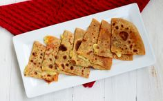 With melted mozerella cheese oozing out of crispy layers of the parantha, Cheese Parantha is as tempting as it looks. Paratha Recipes, India Food, Melted Cheese, Taste Buds, Indian Food Recipes, Brunch, Bread, Layers, Drinks