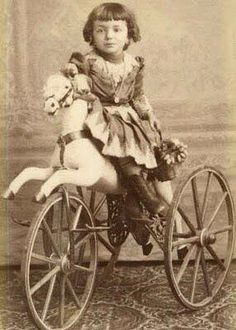 Girl on toy horse.