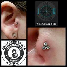 Trinity gem cluster in a tragus piercing. At Neon Dragon Tattoo & Body Piercing.
