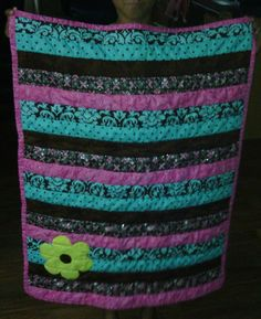 I like the black and with the teals and violets. From the Quilting Board.