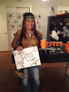 """Diy Halloween Hippie Costume!  Bought the bag, feminist symbol and headband at Party City. The jeans I destroyed myself, they were bootcut, I slit the sides to make bell bottoms, sharpie'd them myself, drew peace signs, flowers, hearts, and the year. And the name of the party host with """"stock"""" like Woodstock...example: their last name & """"stock"""", Corona was their last name, so it was Coronastock '13 :) Wore an off the shoulders shirt in a mustard color with floral embroidery which was…"""