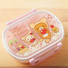 """This Rilakkuma bento box features two inner containers and a lid sealed with a silicone gasket to make sure your food stays fresh! The cute design is from the """"Natural Happy Time"""" series and features Rilakkuma and Korilakkuma enjoying apples together while wearing cute deer outfits!"""