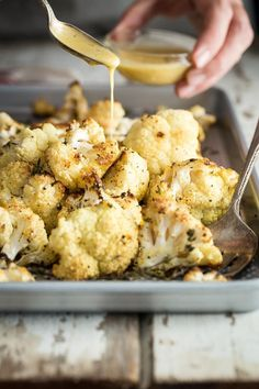 Easy Roasted Cauliflower seasoned with everyone's favorite seasoning lemon pepper, fresh thyme and a sweet Dijon honey dip. cauliflower Roasted Cauliflower with Lemon Pepper and Fresh Thyme Vegetable Dishes, Vegetable Recipes, Vegetarian Recipes, Cooking Recipes, Healthy Recipes, Tasty, Yummy Food, Cauliflower Recipes, Oven Roasted Cauliflower
