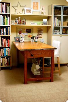 "Desk ""sticking out"" instead of against the wall, shelves give it a ""built in"" feel."