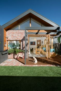 Smart Home / Green Sheep Collective Completed in 2017 in Seddon, Australia. Images by Emma Cross. Smart Home is a renovation and extension to a two-bedroom single-fronted timber Victorian cottage in inner Melbourne. It utilizes a wide range of. Brick Cladding, House Cladding, Brick Facade, Facade House, Modern Brick House, Red Brick Exteriors, Brick Extension, Architects Melbourne, Weatherboard House